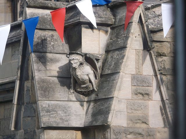 Closeup of bunting and gargoyle on St Mary's church which house The Hub at St Mary's Lichfield