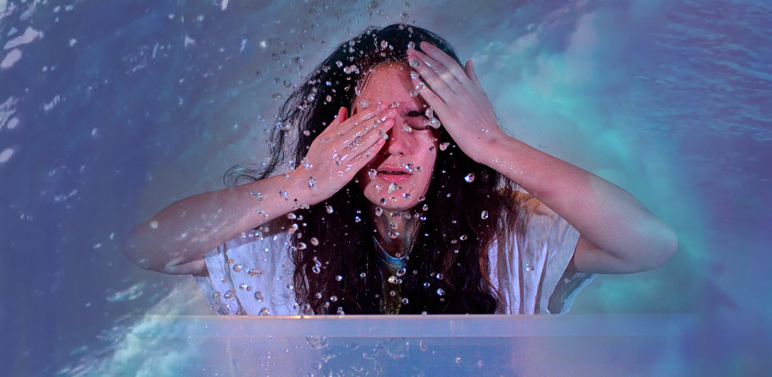 Actor splashes water on her face - The Hub at St Mary's Lichfield